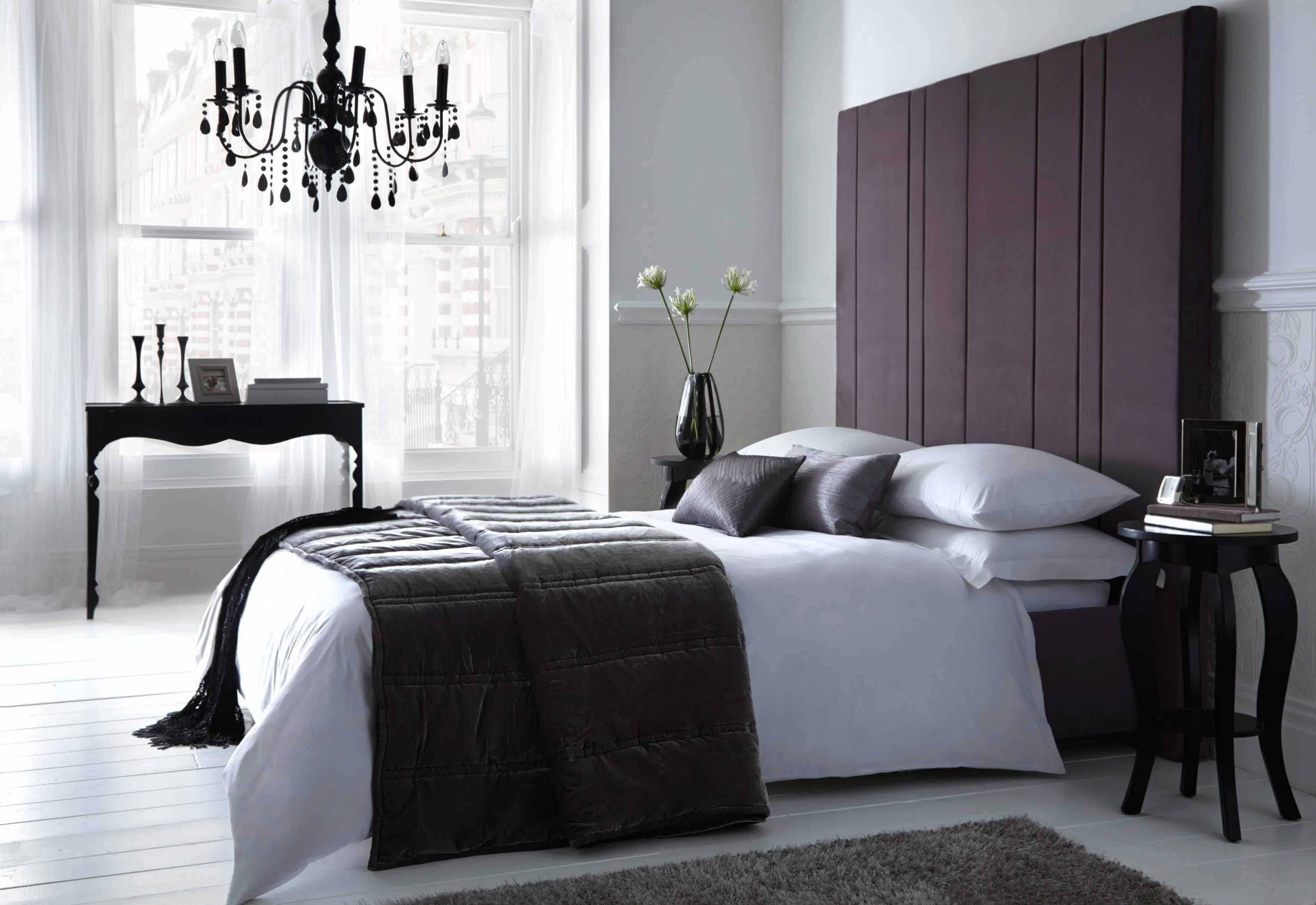 black chandelier in black bedroom