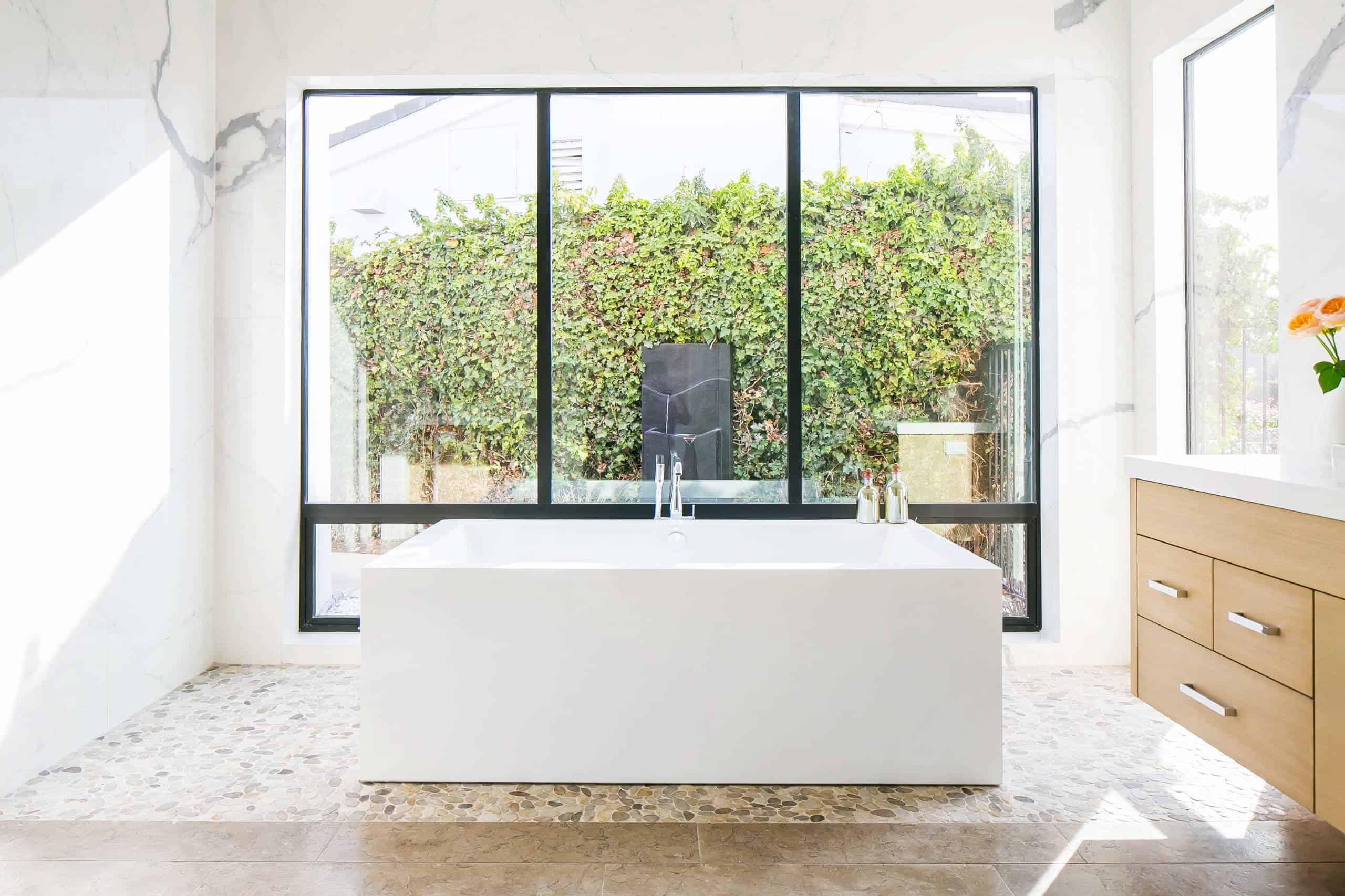 white bathroom with large windows