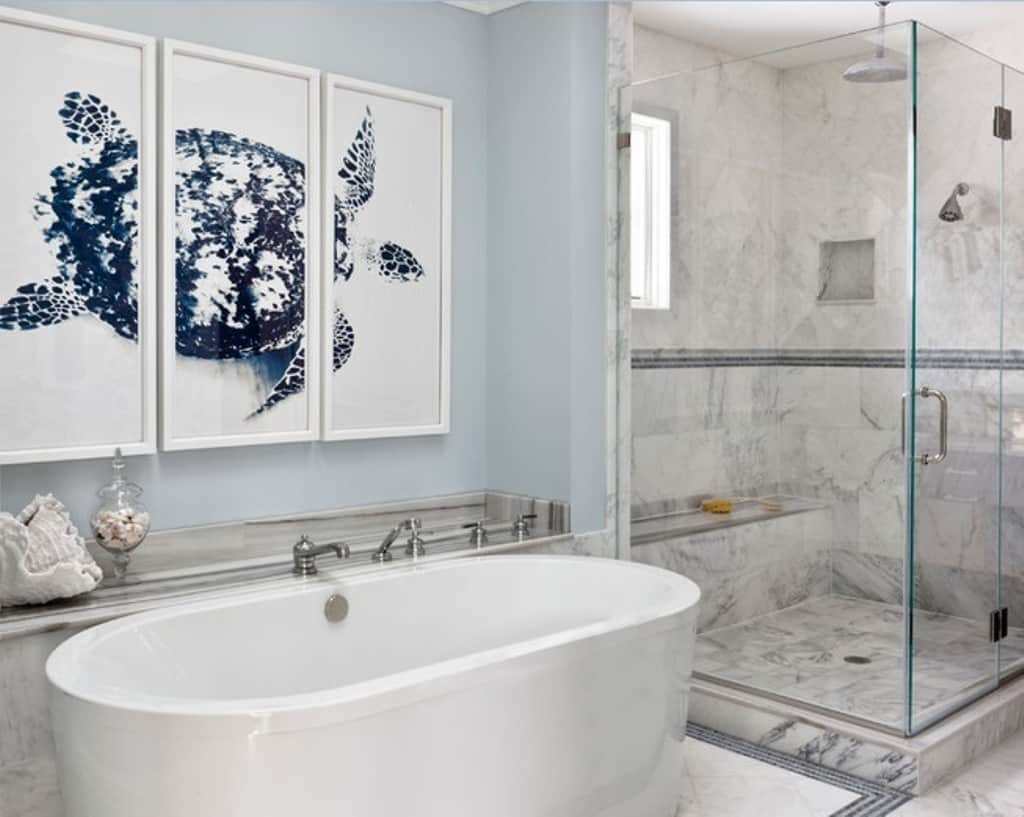 white bathroom with wall art