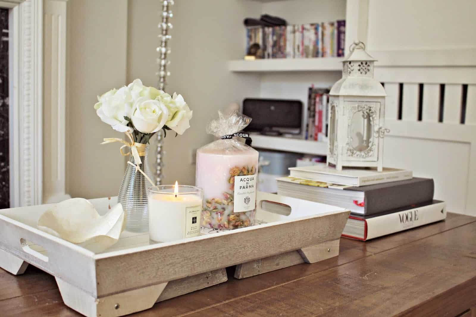 coffee table books and candlee