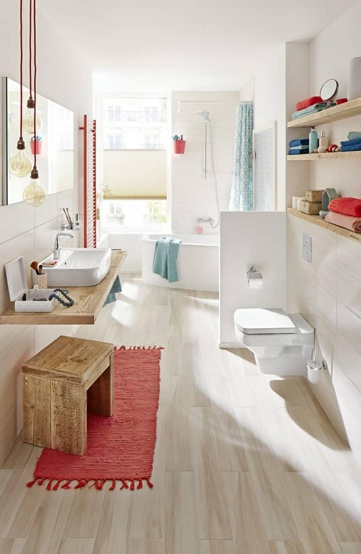 modern light wood tile bathroom with pops of color