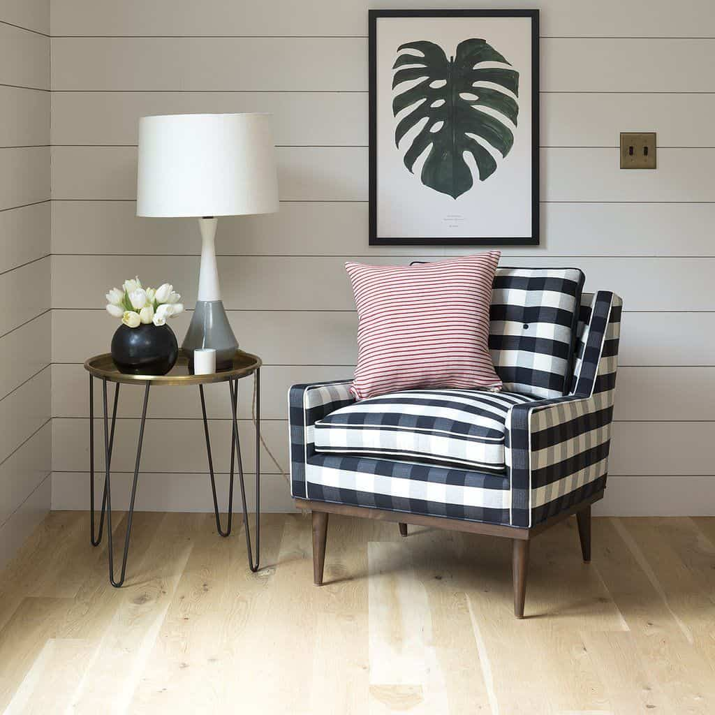 plaid chairs in corner 12 Interior Design Elements To Add To Your Space Right Now