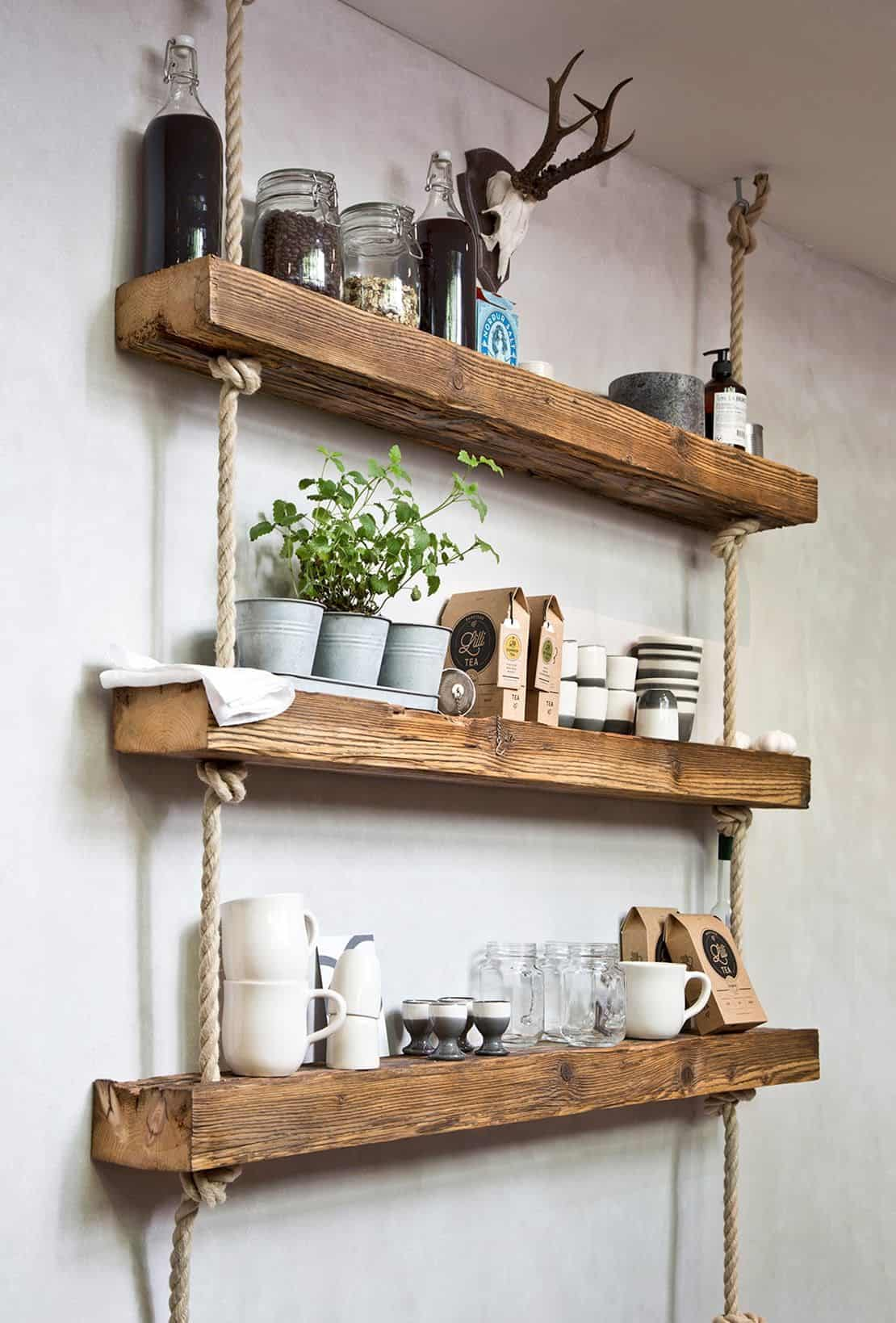 rustic wooden and rope shelves