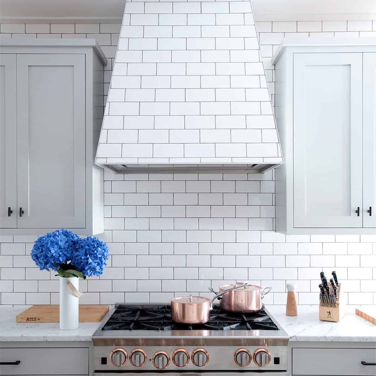 tile kitchen with concealed Chic Kitchens With Concealed Range Hoods