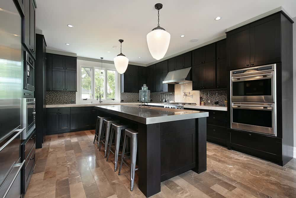 black cabinets with brown tile