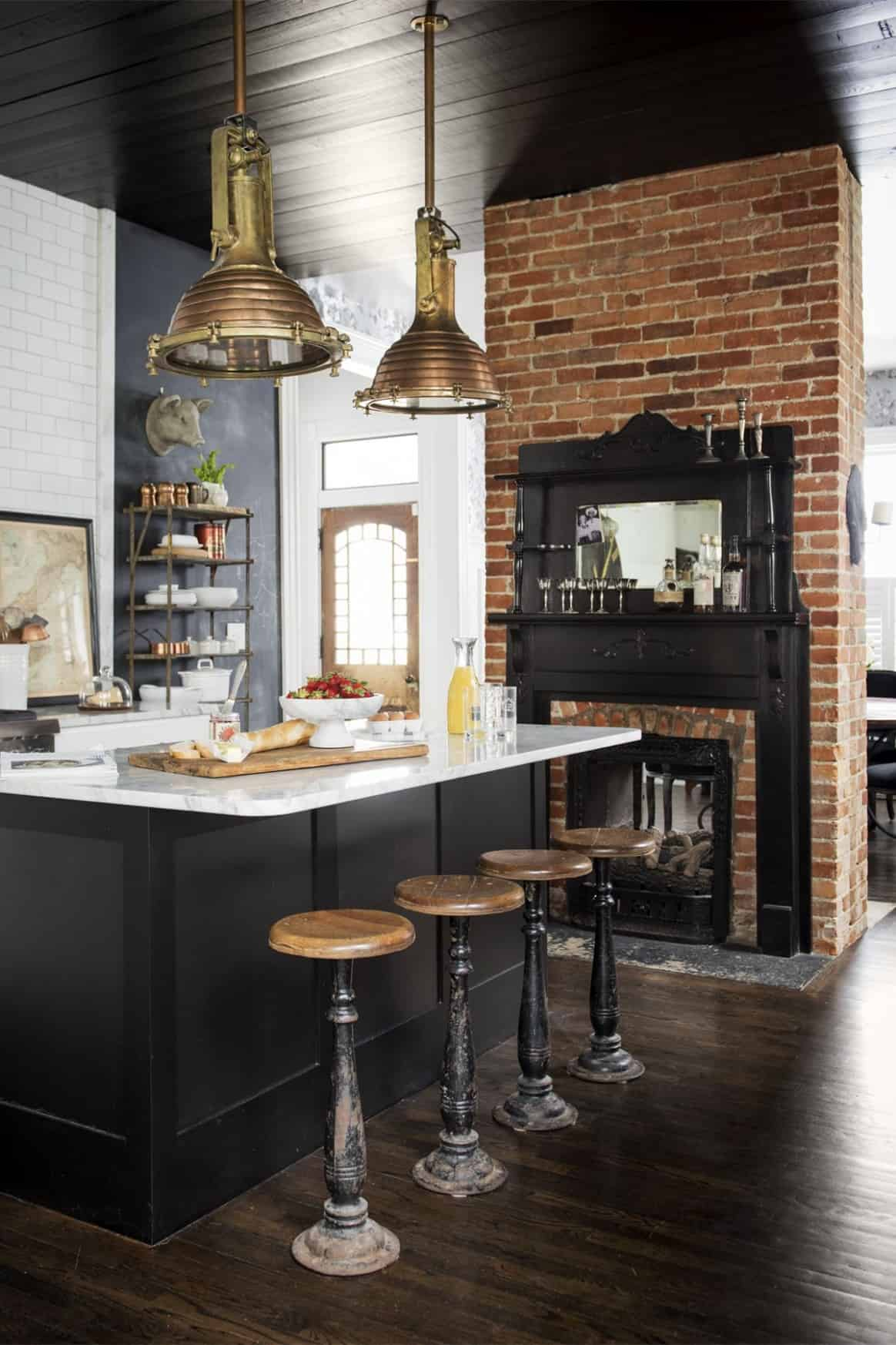 black cabinets with exposed brick wall kitchen