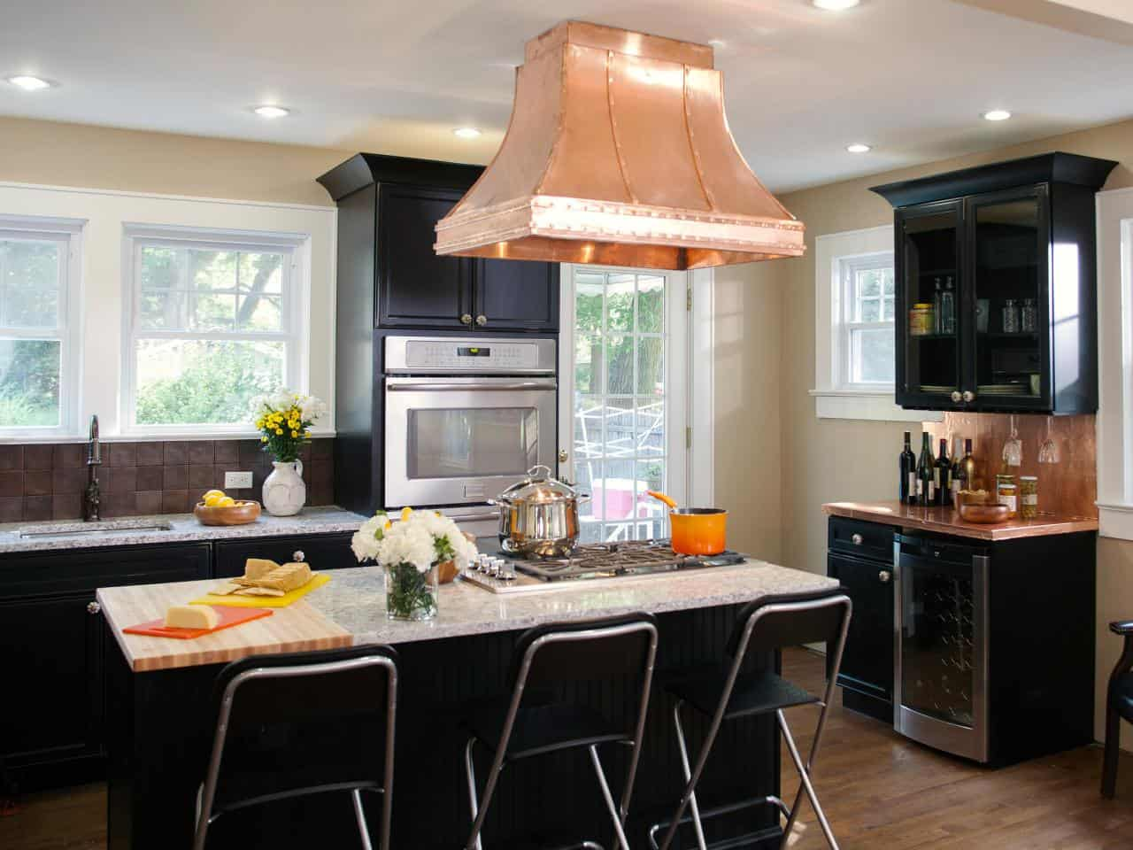 black kitchen cabinets with copper accent
