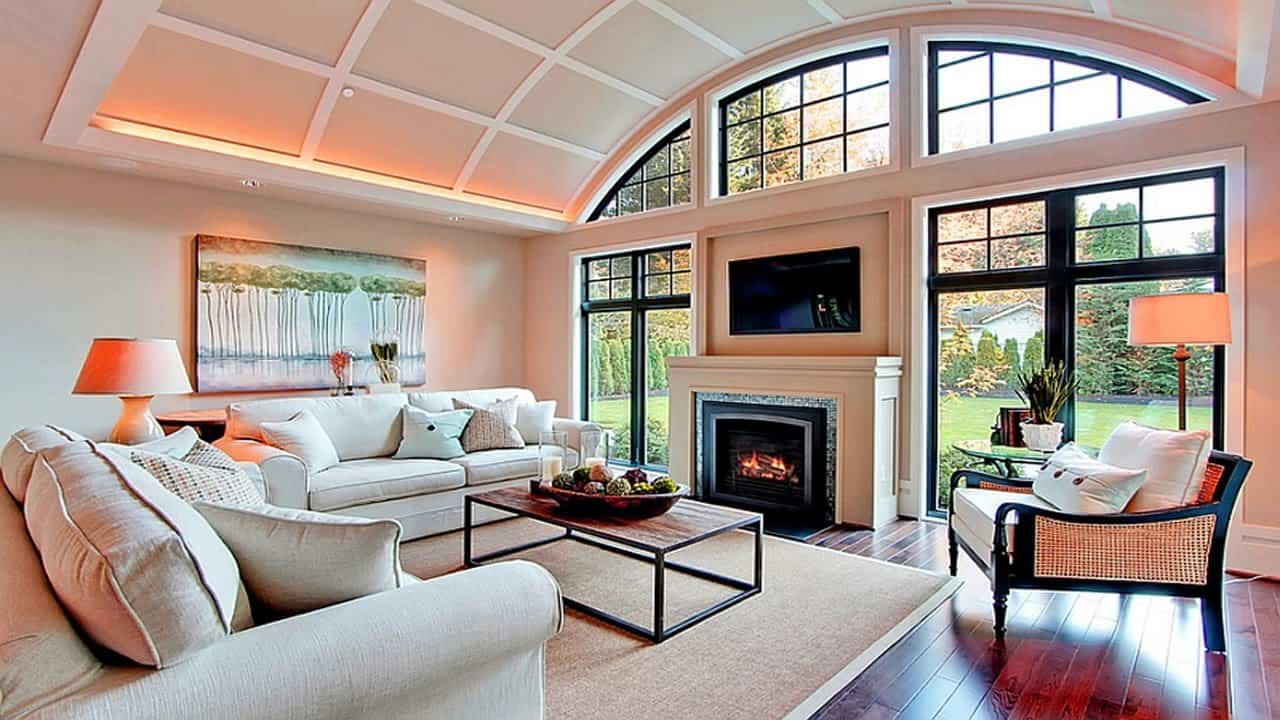 living room with tv ontop of fireplace