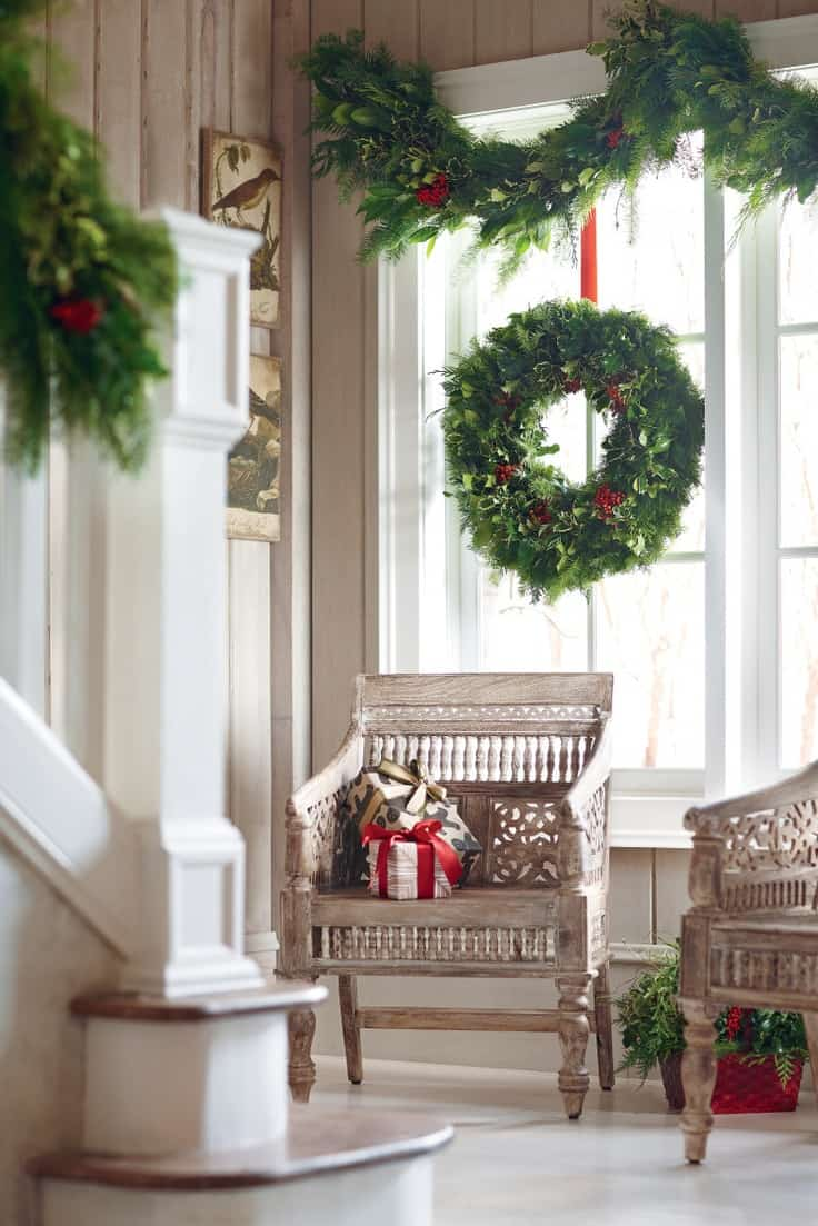 garland at the window 11 Christmas Garlands That Are Totally Goals