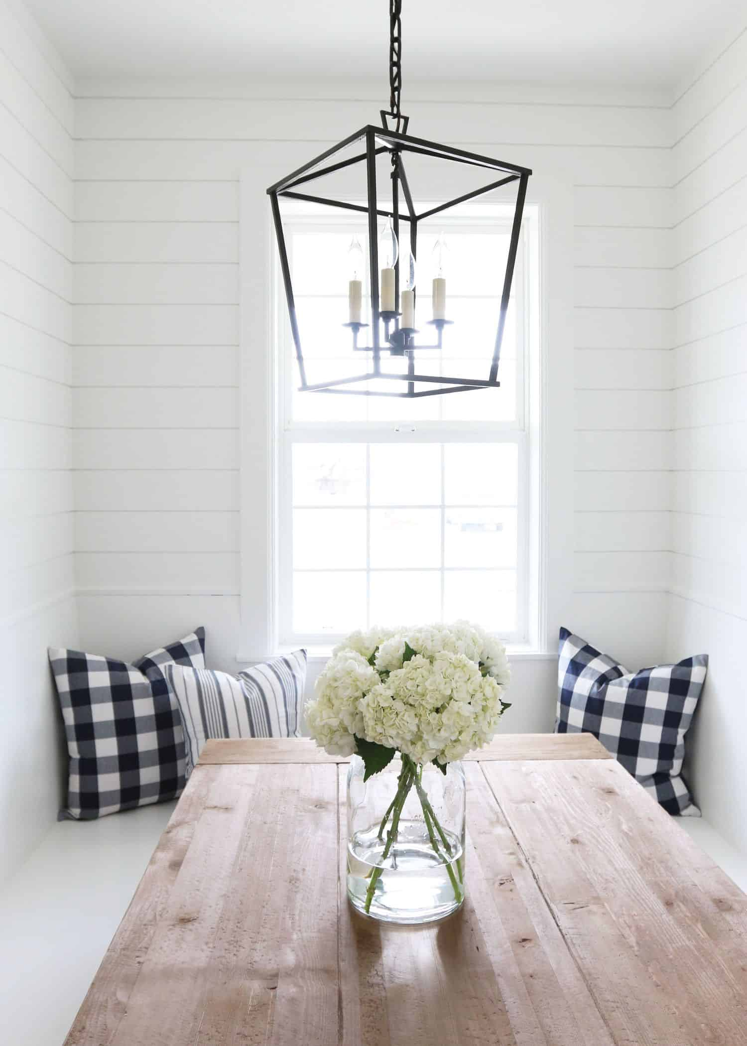 white dining room with lantern