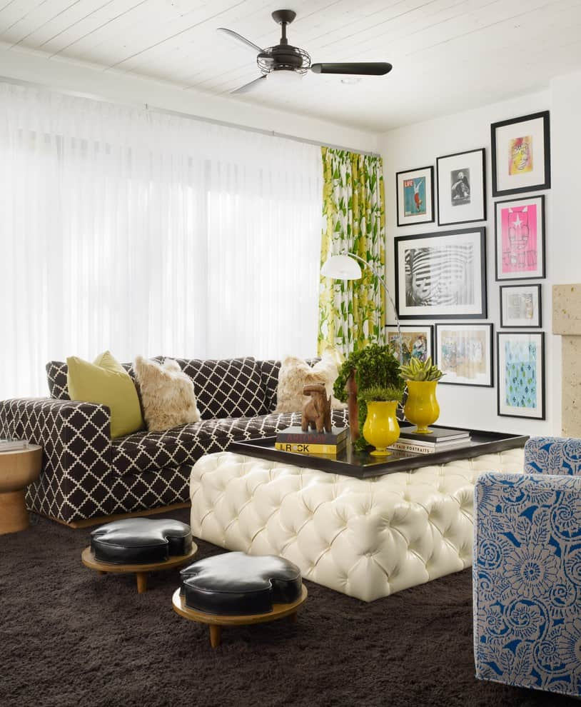 small living room wit extra How To Arrange Your Furniture To Make Any Room Feel Grander