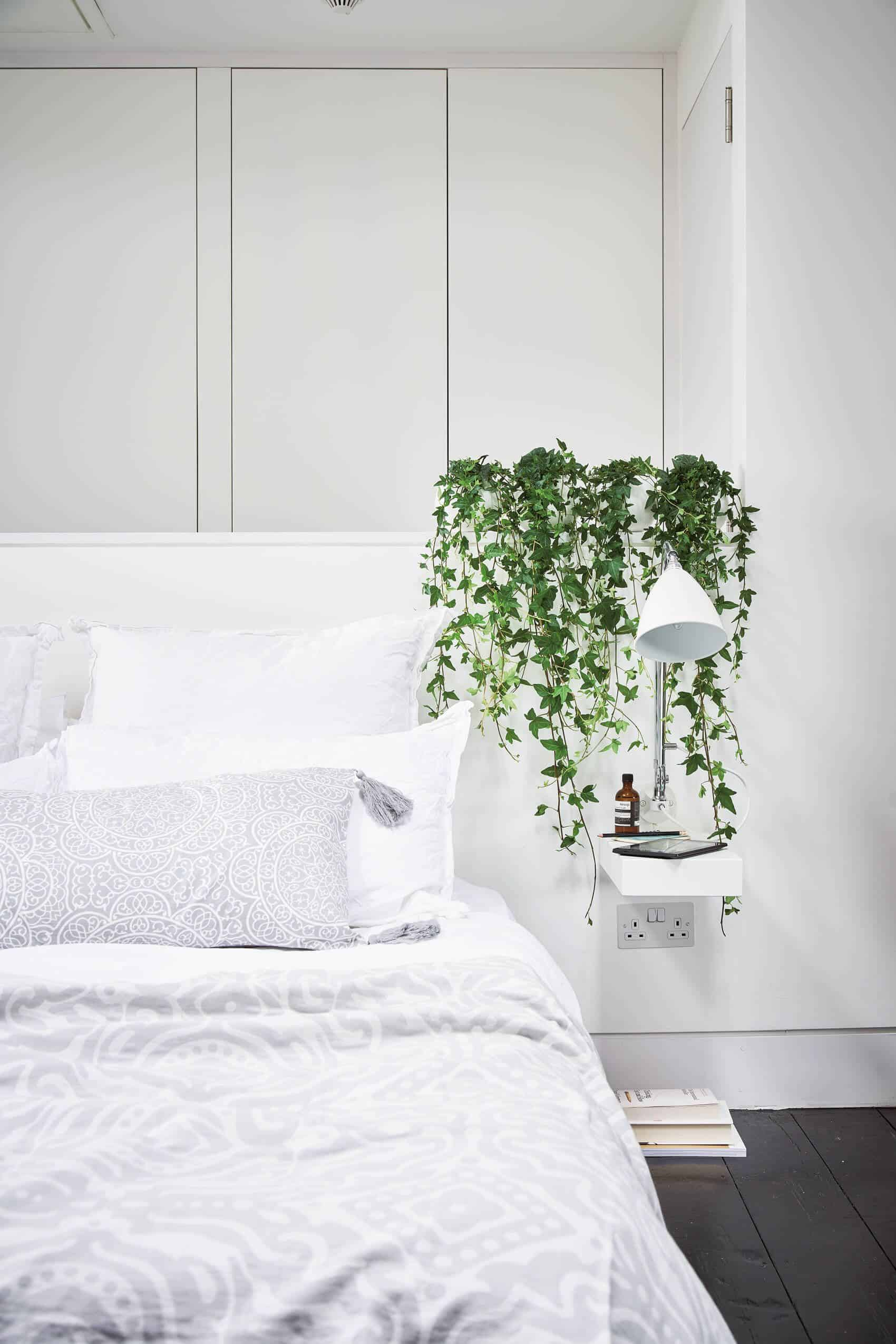 bedroom with cascading palnts