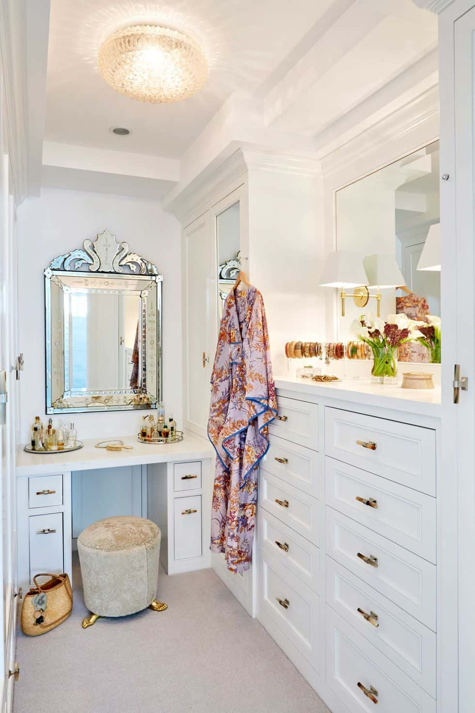 closet with mirror and dresser