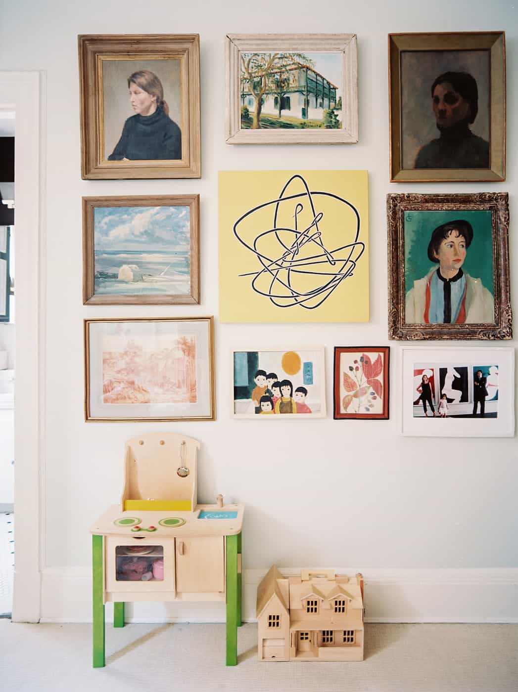 pictures on the wall Kid friendly yet trendy apartment decor