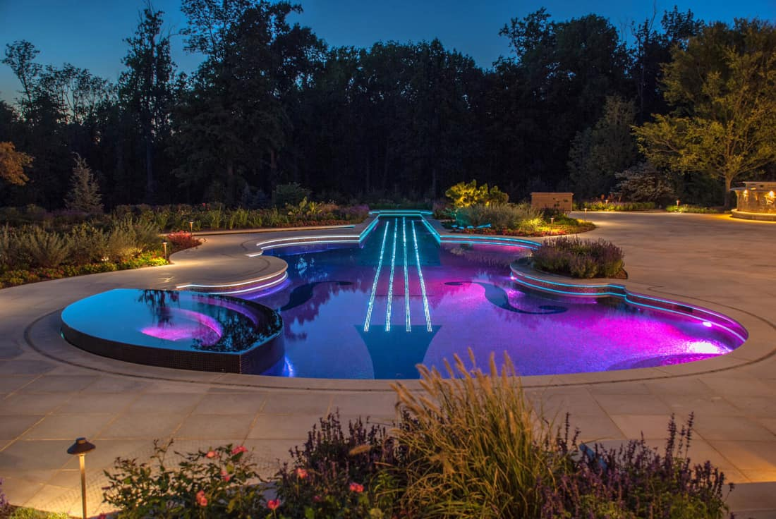 Custom swimming pool by cipriano landscape design beyond for Uses for old swimming pools
