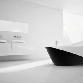 Goccia Bathtub by Marmorin folds open to expose a Sultry Silhouette