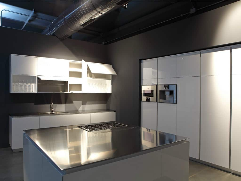 Kitchen with Built-In Griddle Cooktop and Downdraft Vent by Rifra
