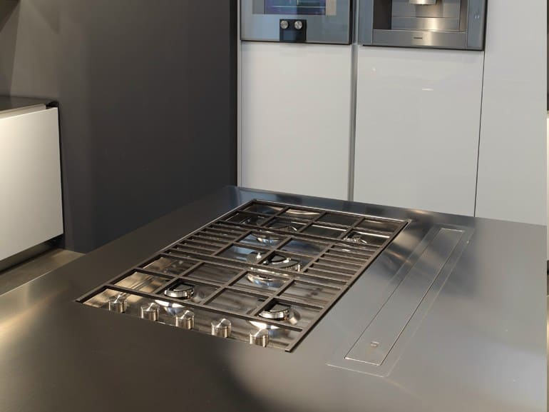 Kitchen With Built In Griddle Cooktop And Downdraft Vent