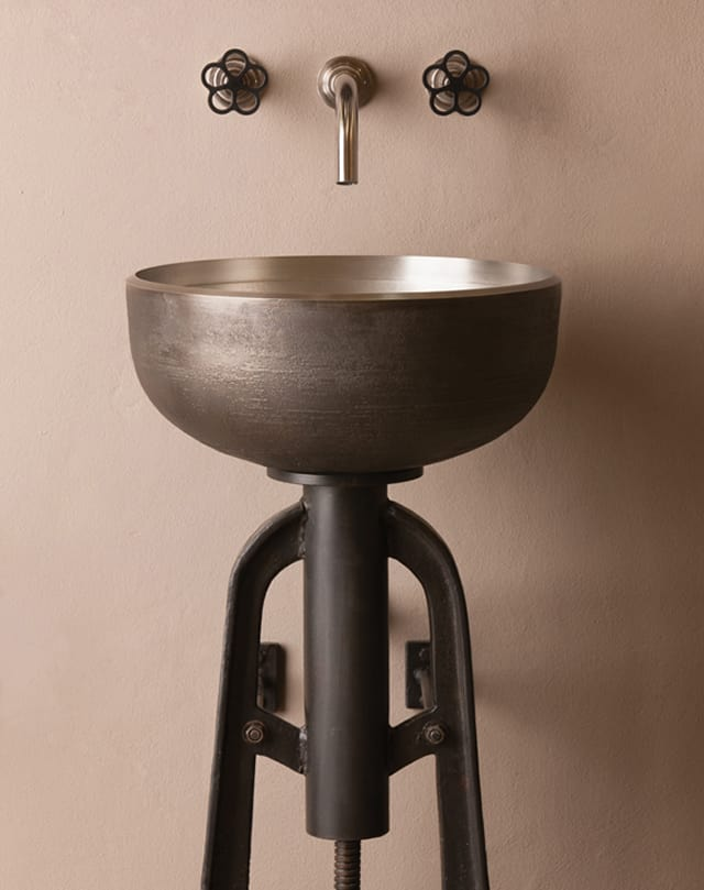 industrial style vessel sink and console by stone forest ore