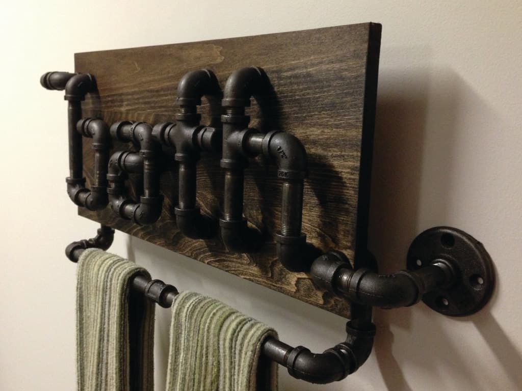 23 awesome plumbing pipe furniture designs for Painting black iron pipe