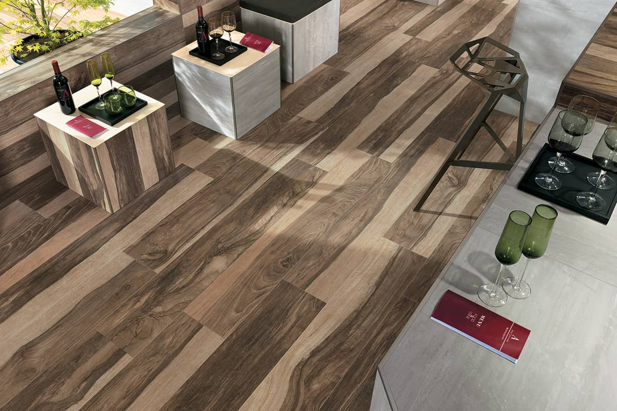 Wood look tile 17 distressed rustic modern ideas for Hardwood floor tile kitchen