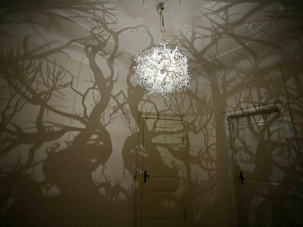 Forms in Nature hanging lights (above and below), an offering from Hilden  and Diaz, creates a forest of shadows on your wall.