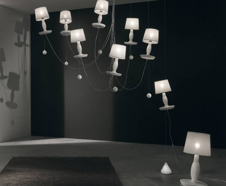 Table lamp shapes suspended from chandelier frames was the brainchild of italian designer edmondo testaguzza