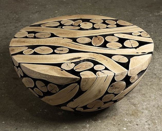 To Create His Coffee Tables Lee Cuts Spherical Compositions In Half