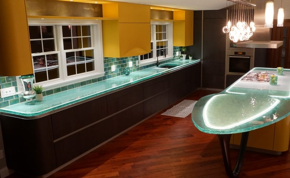 The recycled glass counters look especially nice when lit up (and the glass  subway tile backsplash is a good match).