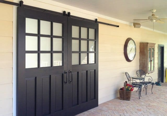 These Exterior Barn Doors Look Striking As You Come In Under The Covered Deck Notice Frosted Window Panes For Privacy