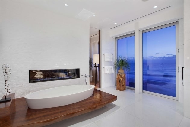 View In Gallery Fireplace Ocean View Florida Bathroom Canoe Shaped Tub 3