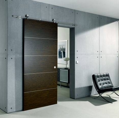 Contemporary Sliding Door from Bartels – an exposed stainless steel rail system