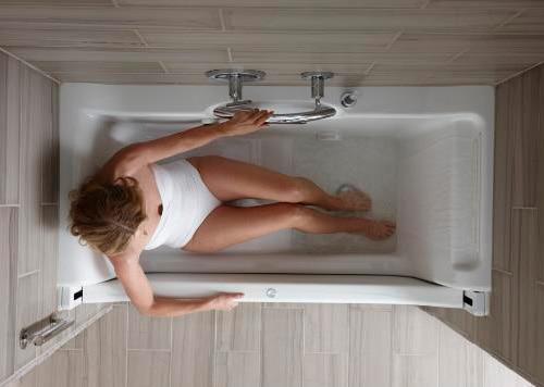 easy-access-bathtubs-rising-wall-bath-elevance-kohler-3.jpg