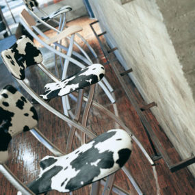 Metal Folding Bar Stool from Ozzio – cute stools come even in cowhide!