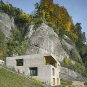 Hillside Home Is Wood Frame Construction With Concrete Facade