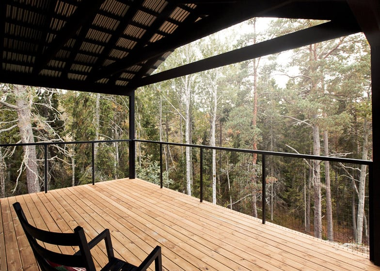 Single Story Summer House Overlooks Forested Gorge In Sweden