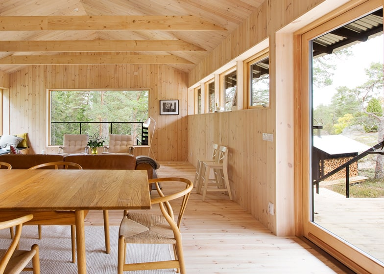 View in gallery single-storey-summer-house-overlooks-forested-gorge-sweden-