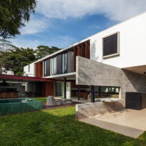 Dual Direction Concrete Home Surrounds Poolside Courtyard in Brazil