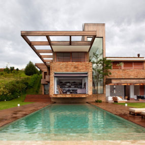 Contemporary Hillside Home in Brazil Disappears into the Landscape