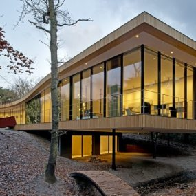 X-Shaped Villa Curves Through Oak Forest in The Netherlands