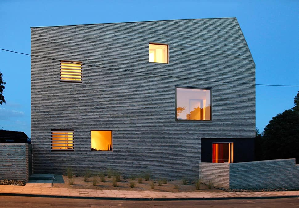 Narrow Lot Uses Modern Fortress Wall for Privacy from Street