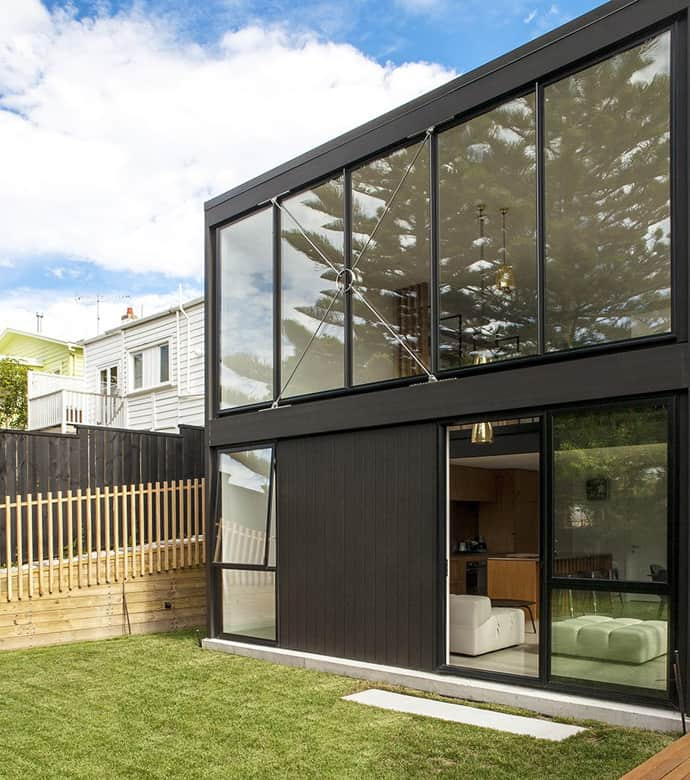 Traditional cottage in new zealand expanded into modern for Contemporary house designs nz