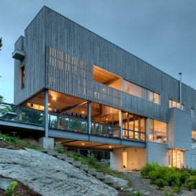 Steel and Wood Bridge House Spans 2 Seaside Rocky Outcrops