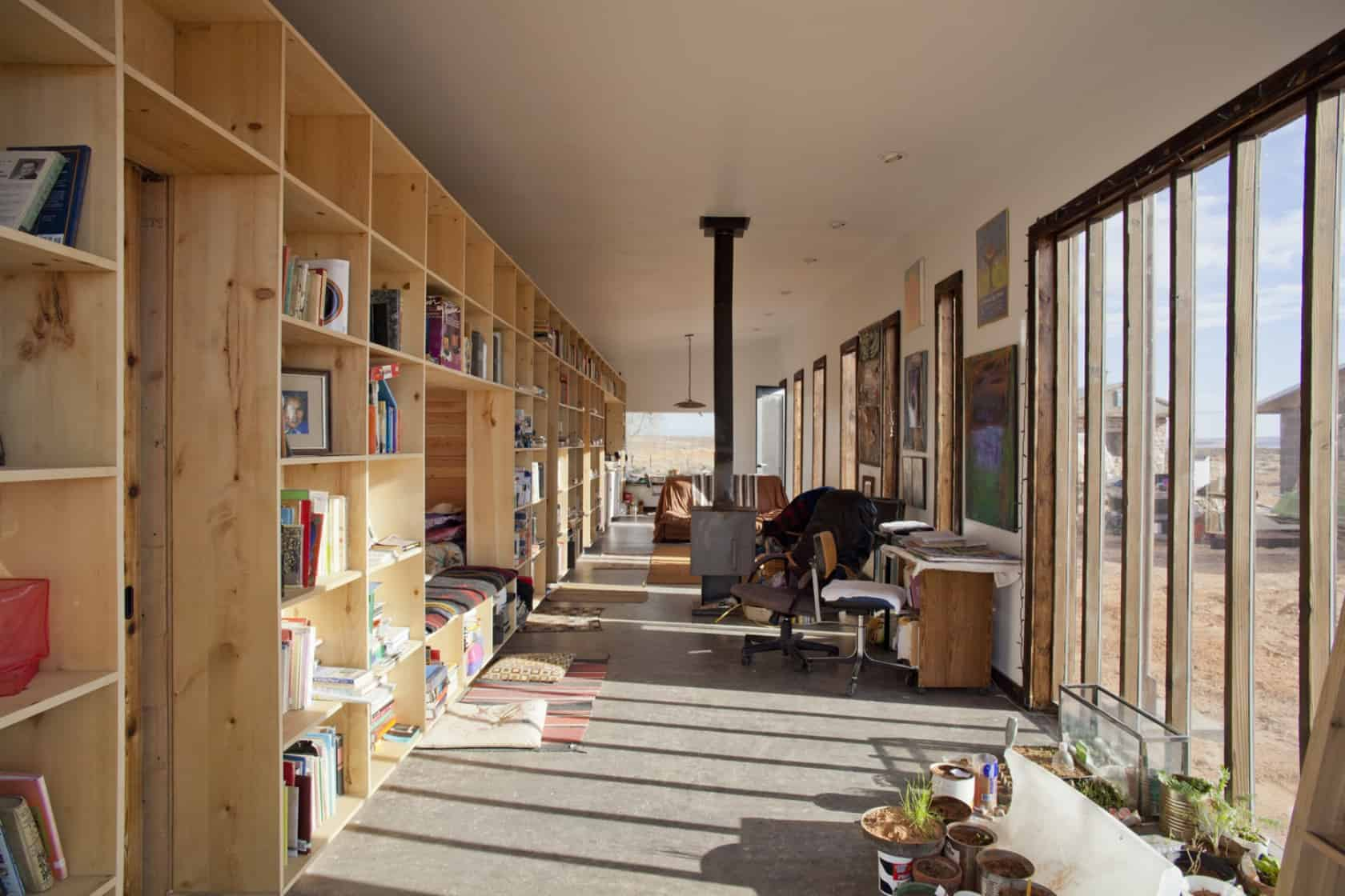 Nakai House In Utah Features Wall Of Shelves With Bedroom
