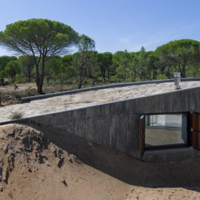 Concrete House Buried Under Artificial Sand Dunes