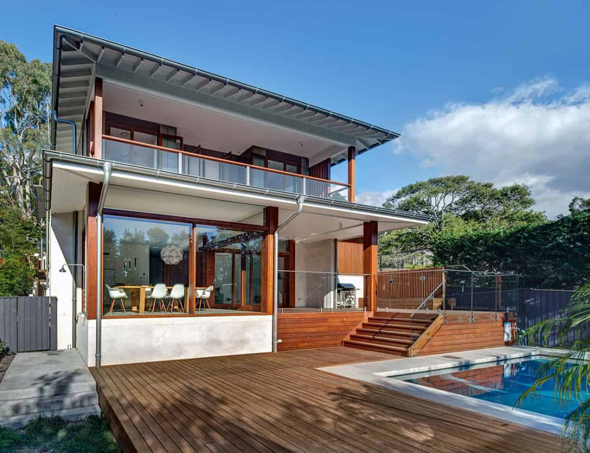 Corrugated Steel House with Warm Wood Details Throughout
