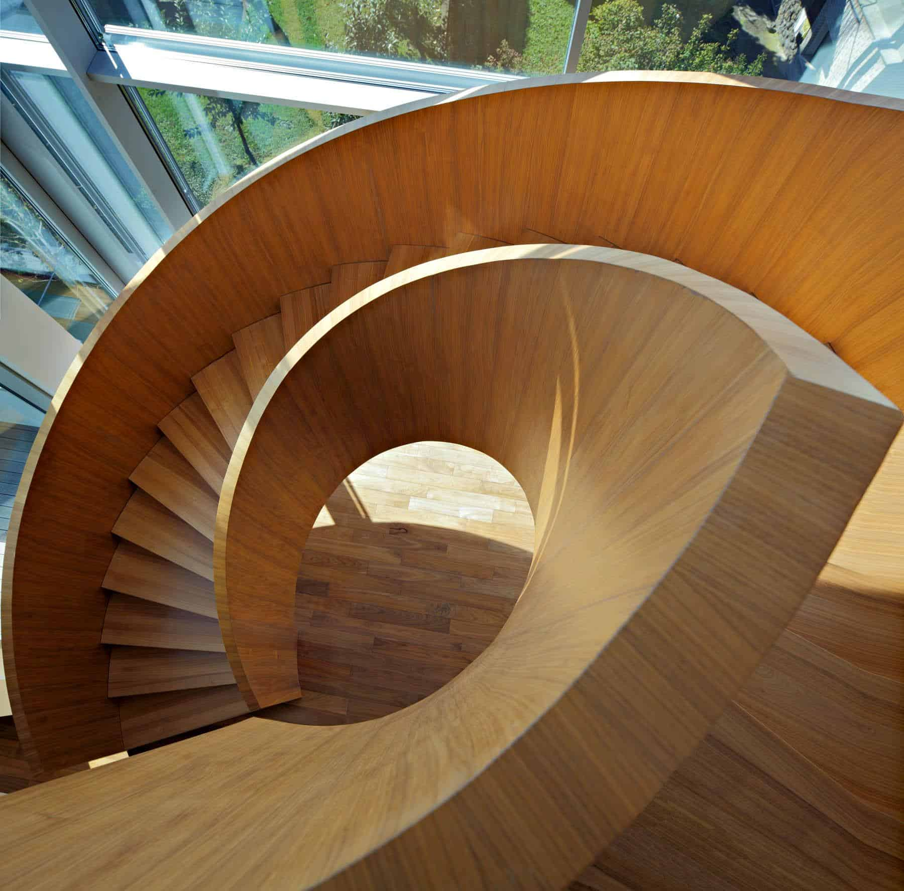 Concrete Circular Stairwell Focus of Minimalist Residence