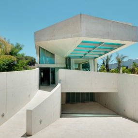 Concrete Home Features Pool with Glass Floor