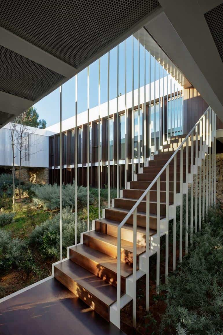 Prefabricated Home Surrounds Sloped Courtyard With 17th