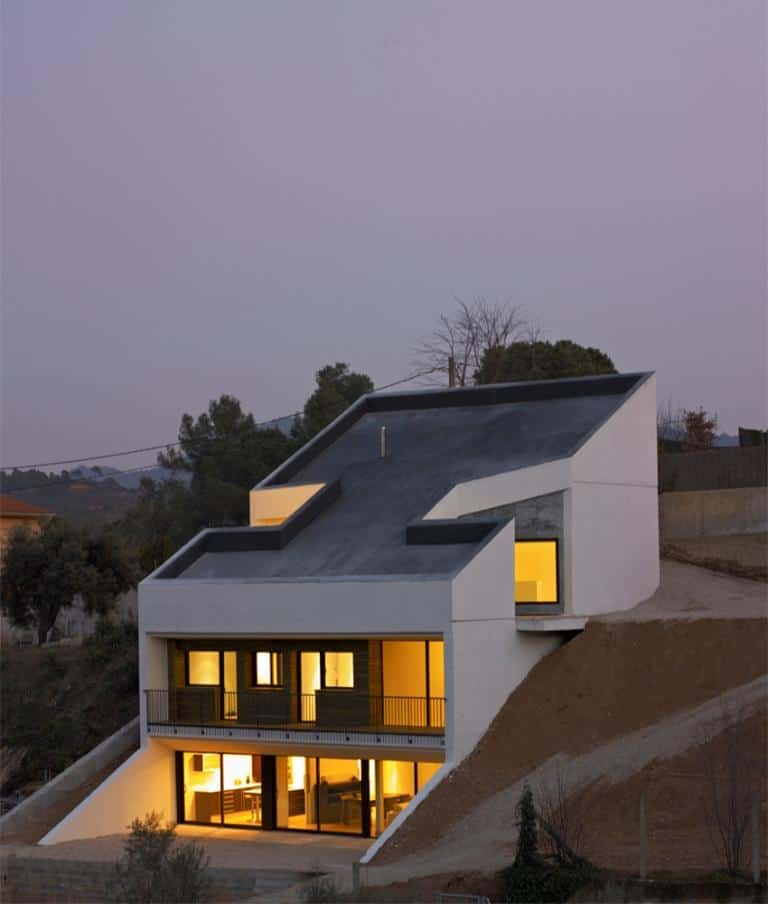Concrete House Embedded in the Slope
